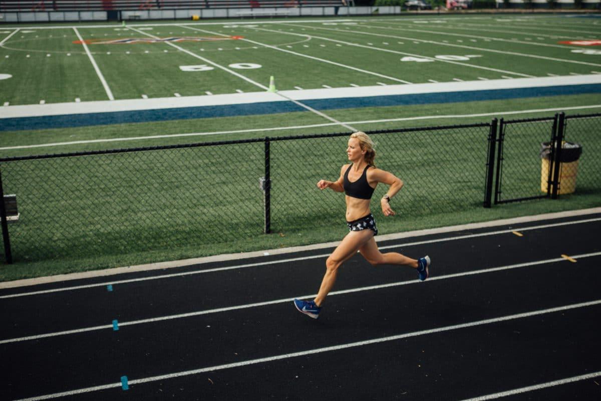 mother runner running on track.